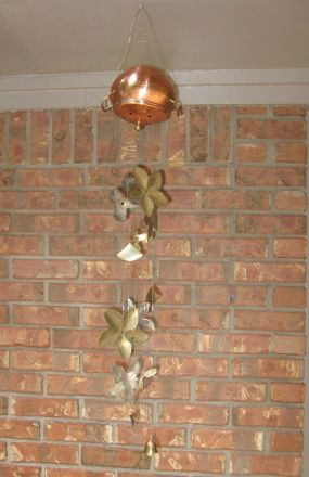 Windchime made from potpourri simmer pot and brass candle holders.